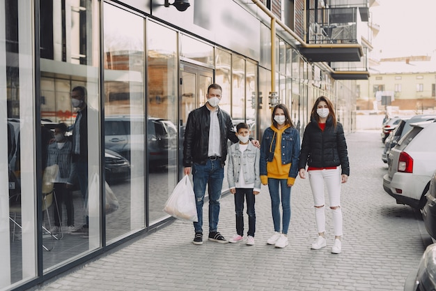 Family in protective masks with purchases