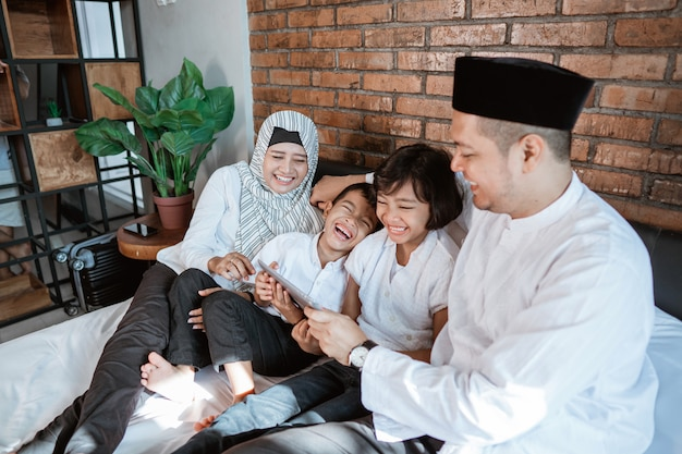 Family on ramadan kareem using tablet