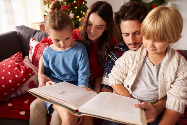 Family reading book at the christmas