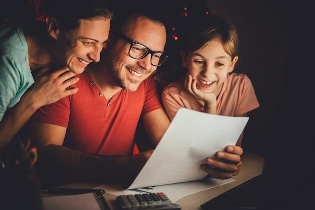 Family reading letter