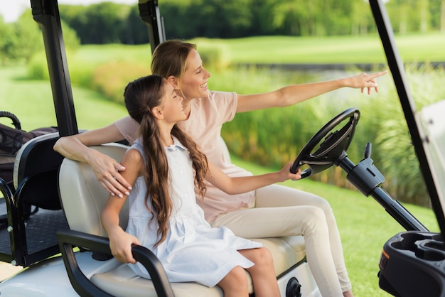 Family relationships golfers enjoy golf course.