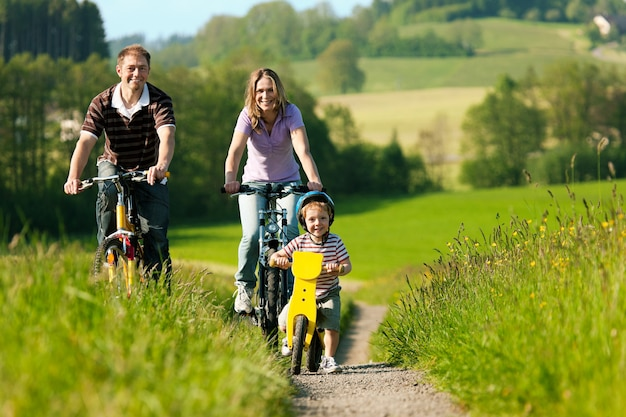 Family riding bicycles in summer