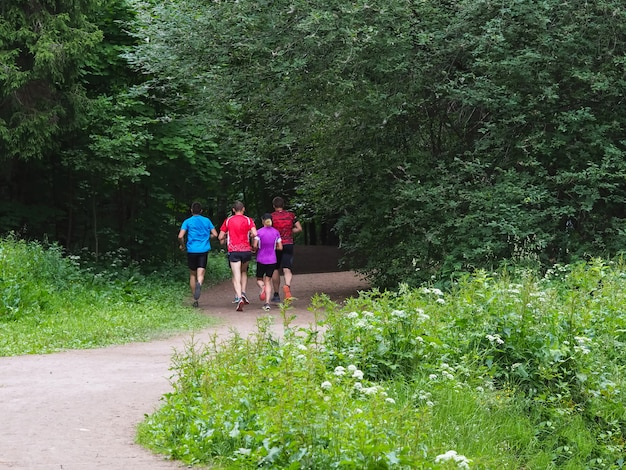 A family of runners on a morning jog in the park