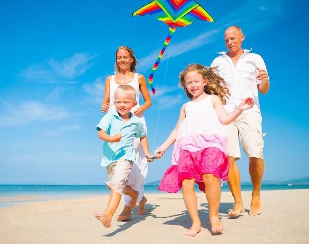 Family running on the beach.