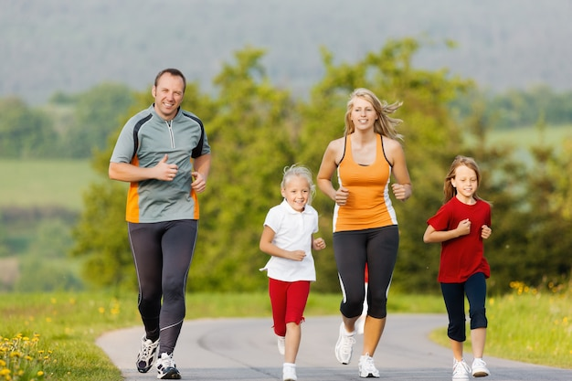 Family running for sport outdoors
