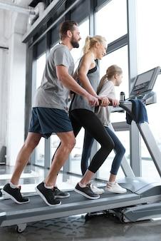 Family running on the treadmill