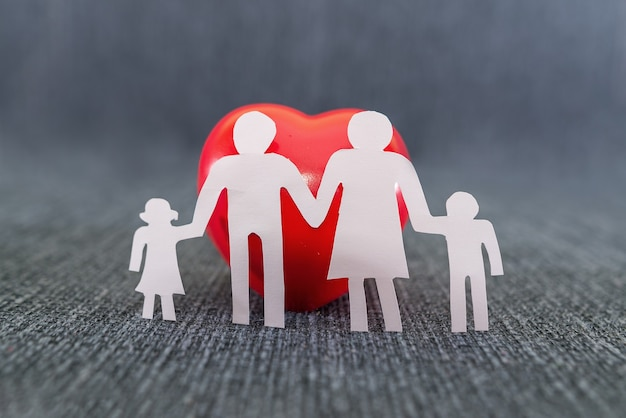 Family silhouette and red heart. world family day