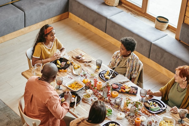 Family sitting at holiday dining table
