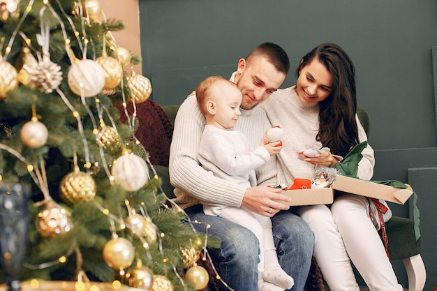 Family sitting at home near christmas tree