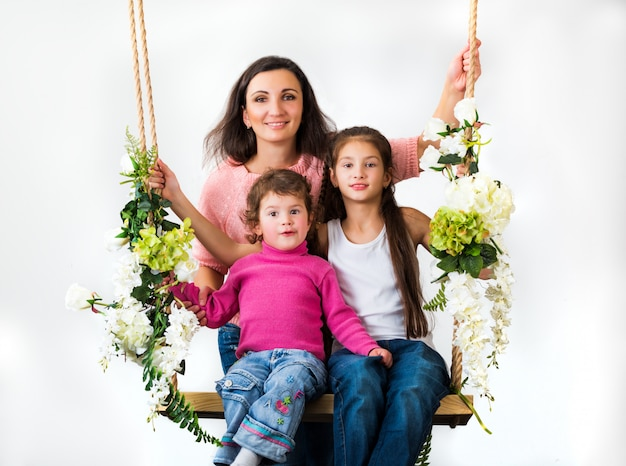 Family sitting on a swing of flowers