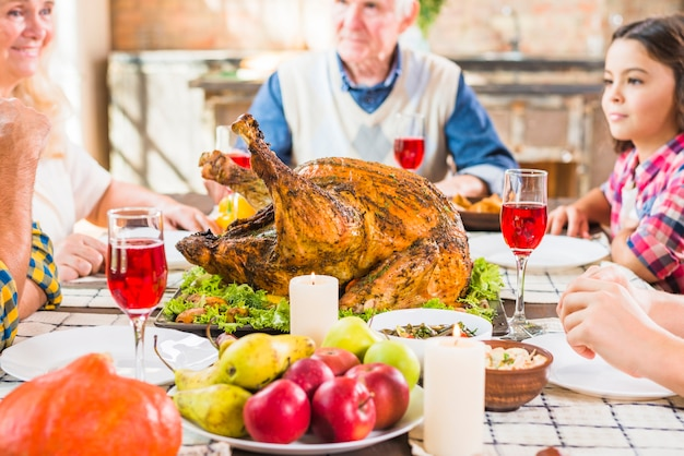 Family sitting at table with backed ham