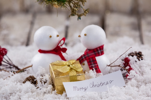 Family of snowmen with a message of merry christmas