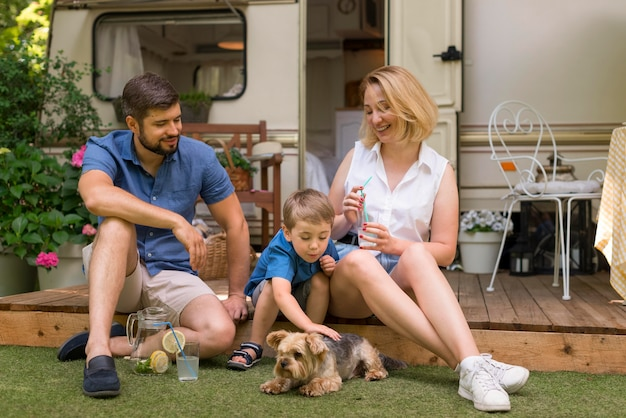 Family spending time together with their dog