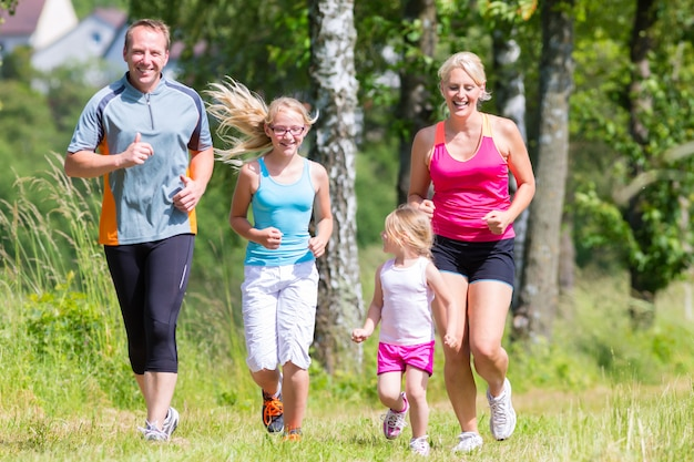 Family sport jogging through field