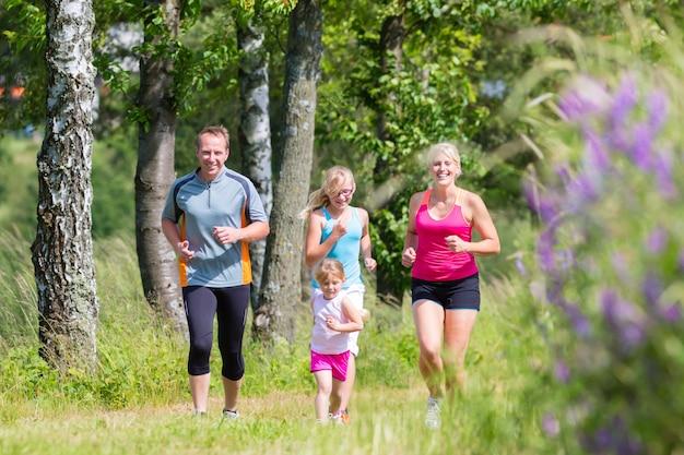 Family sport jogging through field