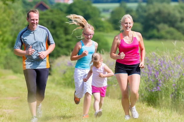 Family sport running through field