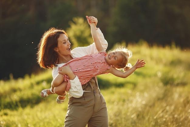 Family in a summer field. sensual photo. cute little girl.