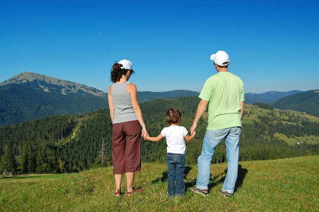 Family summer vacation in mountains