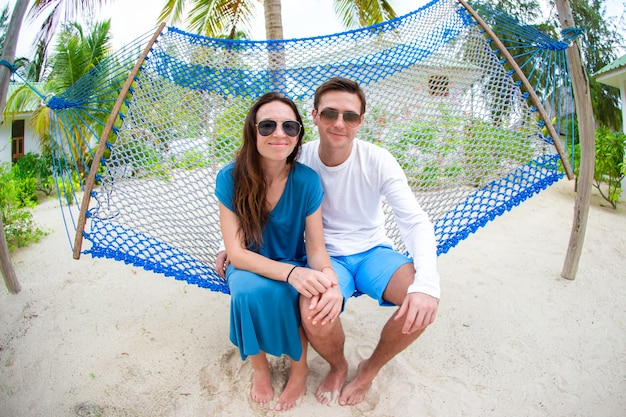 Family on summer vacation relaxing in hammock