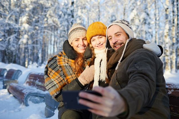 Family taking photo in winter