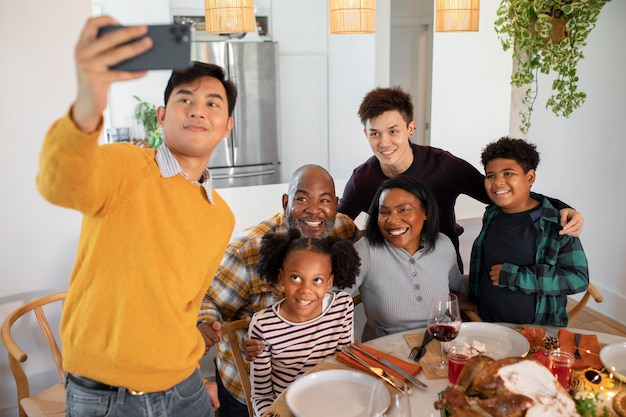 Family taking a selfie before thanksgiving day dinner