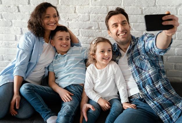 Family taking selfies medium shot