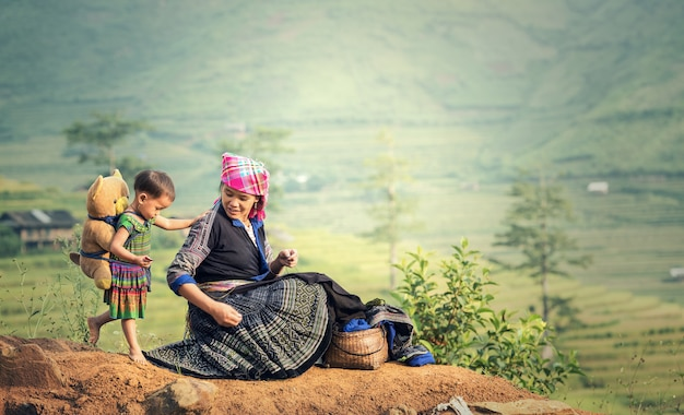 Family tribal mother and daughter in rice terraces, tu le lao cai, vietnam