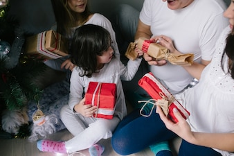 Family unwrapping gifts