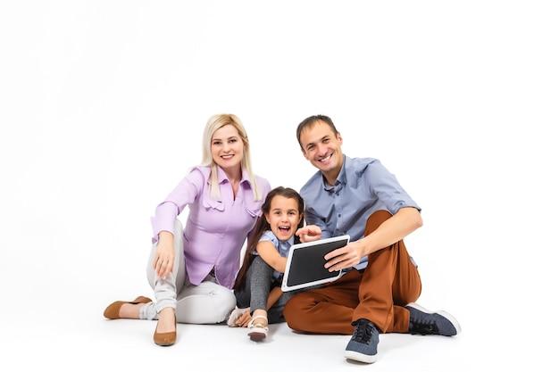 Family using digital tablet laptop