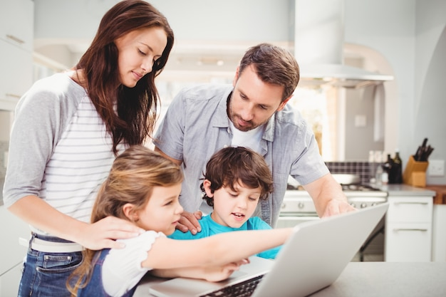 Family using laptop on table