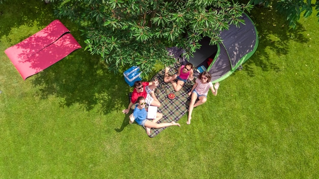 Family vacation in campsite aerial top view