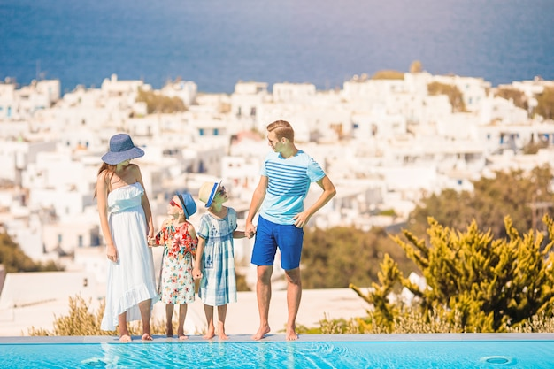 Family on vacation in mykonos town, greece Premium Photo