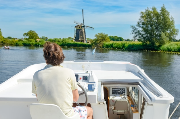 Family vacation, summer holiday travel on barge boat in canal