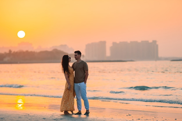 Family vacation. young couple on the beach at sunset in uae