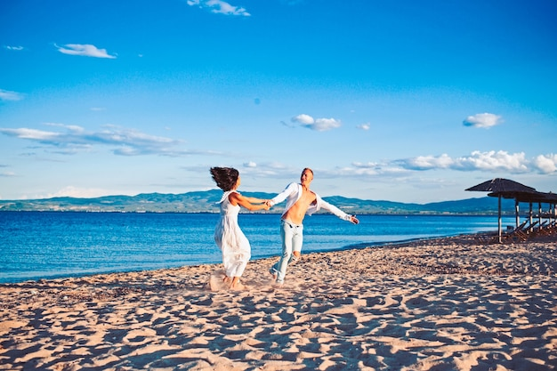Family and valentines day. summer holidays and travel vacation. sexy woman and man at sea. couple in love dance on beach. love relations of dancing couple enjoying summer day together.