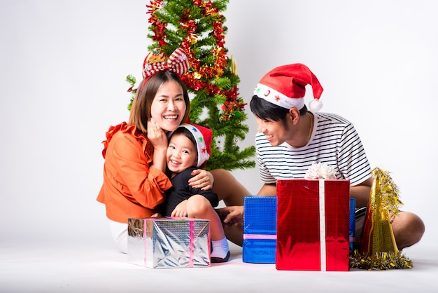 Family very happy with gift a day christmas and happy new year on background in studio