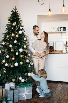 Family waiting for christmas in kitchen