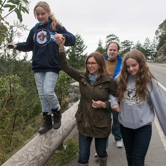 Family walking on the road, deception pass state park, oak harbor, washington state, usa