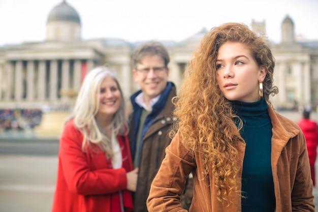 Family walking in trafalgar square, london