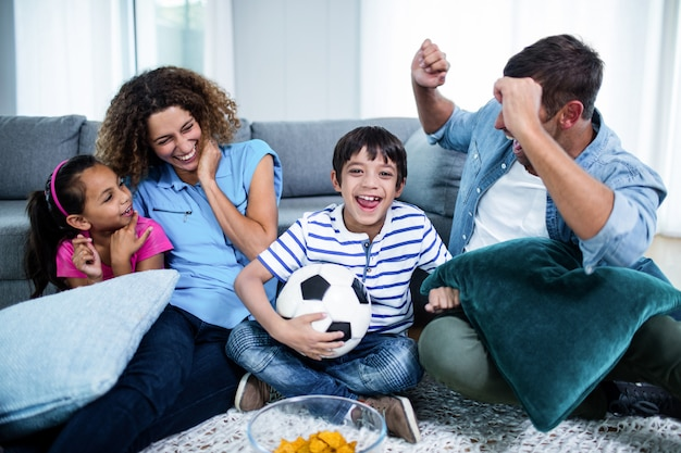 Family watching match together on television