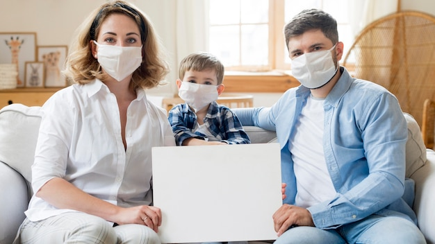 Family wearing medical masks indoors