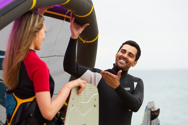 Family in wetsuits with surf boards