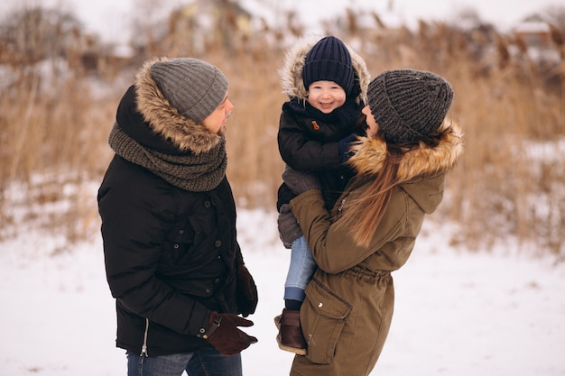 Family in winter in forest with son