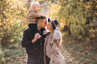 Family with a little son in autumn park