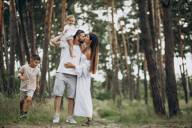Family with baby daughter and little son in park