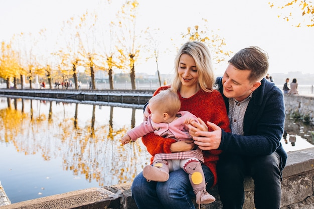Family with baby daughter walking in park