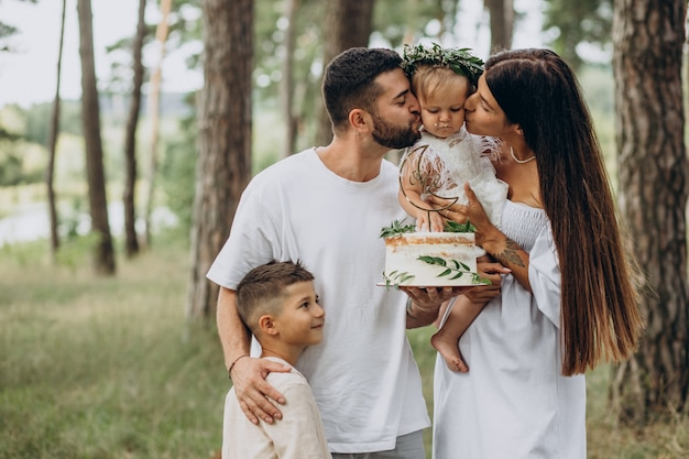 Family with baby girl and little son celebrating birhtday party