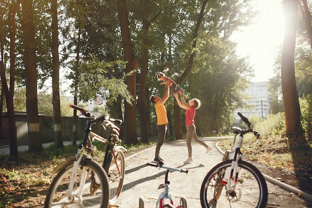 Family with a bicycle in a summer park