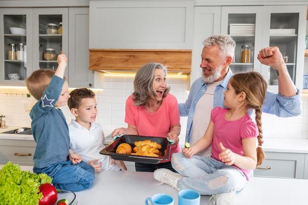 Family with croissants medium shot