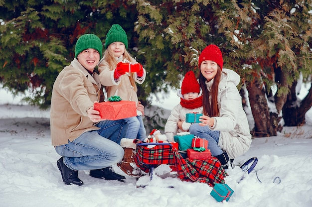 Family with cute daughters in a winter park